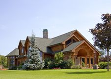 Executive Log Estate. A very modern log home with vintage charm in the country for the wealthy. Vintage in style Stock Photo