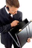 Executive looking his empty briefcase Royalty Free Stock Photo