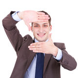 Executive making frame with his hands Stock Photo