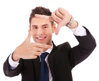 Executive making frame with his hands Royalty Free Stock Images