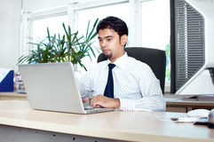 Executive male working on laptop Royalty Free Stock Images