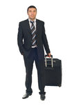 Executive man go to business travel. Full length of business man go to business travel and holding luggage isolated on white background Royalty Free Stock Photos