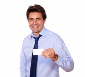 Executive man holding up his blank business card Stock Image
