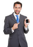 Executive man pointing out his smart phone Stock Photography