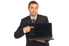 Executive man pointing to laptop screen Royalty Free Stock Photo