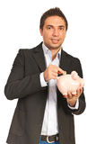 Executive man saving money Royalty Free Stock Image
