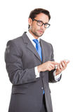 Executive man texting on his smart phone Stock Image