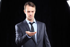 Executive man touching an imaginary screen Royalty Free Stock Photo