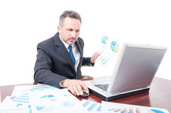 Executive manager analysing charts and diagrams Royalty Free Stock Photos
