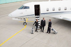 Executive manager in front of corporate jet Stock Images