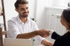 Executive manager handshaking vacancy candidate before interview or after hiring. Smiling executive manager handshaking female vacancy candidate before interview stock image