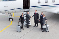 Executive manager leaving corporate jet Stock Image