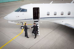Executive manager leaving corporate jet Royalty Free Stock Photography