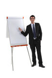 Executive next to flipchart Stock Photo