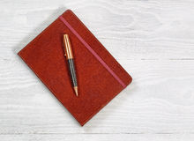Executive notepad with Pen on rustic white wood Royalty Free Stock Image