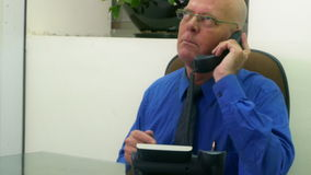Executive in office on phone, upset stock video