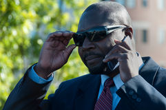 Executive On Cell Phone Wearing Sunglasses Royalty Free Stock Image
