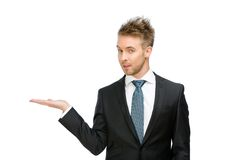 Executive with palm up Stock Images
