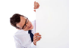 Executive peeping from behind empty signboard Royalty Free Stock Images