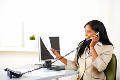Executive on phone and looking to documents Royalty Free Stock Photos