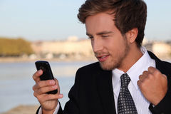 Executive pleased with phone message Royalty Free Stock Photo