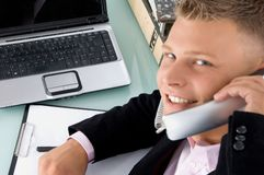 Executive Posing With Phone Receiver Royalty Free Stock Image
