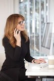 Executive professonal woman with mobile phone Royalty Free Stock Images