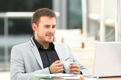Executive reading on line content in a coffee shop Stock Photography