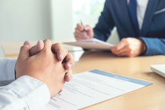 Executive reading a resume during a job interview and businessma. N Completing Application Form. Hiring concept stock photography