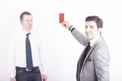 Executive showing assistant red card Royalty Free Stock Images