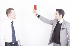 Executive showing assistant red card Stock Images