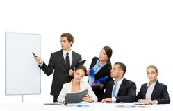 Executive showing something on screen to the group of people. Manager showing something on screen to the group of executives, isolated. Concept of teamwork and stock photos