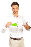 Executive showing to green card Royalty Free Stock Photography