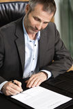 Executive signing a contract. Royalty Free Stock Image