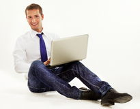 Executive sitting on the floor  with laptop Stock Image