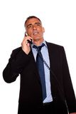 Executive speaking on phone Stock Photos