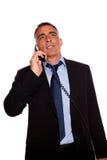 Executive speaking on phone Stock Photos