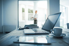 Executive standing in his office Stock Image