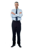 Executive standing isolated over white Royalty Free Stock Image