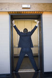Executive stretched in elevator Royalty Free Stock Image