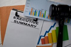 Executive Summary text write on a paperwork and gavel isolated on office desk