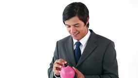 Executive taking notes from his piggy bank Royalty Free Stock Photos