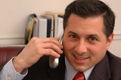 Executive  taking on phone in office Stock Photography