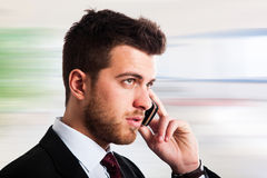 Executive talking at phone Royalty Free Stock Images