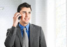 Executive talking at phone Stock Photo