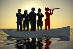 Leader on boat with a spyglass telescope at sunset. An executive team led by a bold leader looking through a spyglass telescope on a boat navigating towards Stock Image