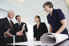 Executive team reviewing plans. Royalty Free Stock Photography