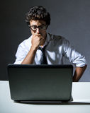 Executive thinking in front of his laptop Royalty Free Stock Image