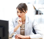 Executive thinking while working at office Stock Photography