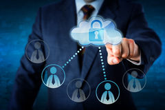 Executive Touching Locked Cloud Linked To Peers. Torso of business executive lifting index finger to touch a locked cloud button connected to peers. Two Royalty Free Stock Images